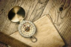 Vintage paper with compass  on old wooden boards Stock Photos