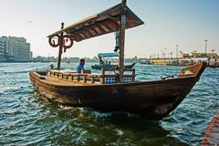 traditional abra ferries at the creek in dubai - stock photo