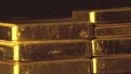 Stock Video Footage of Gold bullion bars stacked up