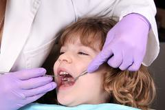 Child patient at the dentist dental examine Stock Photos