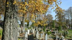 People care family graves beautiful autumn cemetery graveyard Stock Footage