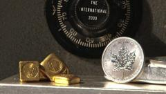 Gold and silver bullion coins inside safe Stock Footage