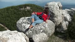 Woman posing resting on a rock Stock Footage