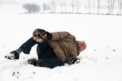 senior man winter accident fall on snow - stock photo