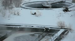 Zoom out from aeration tanks of industrial treatment plant Stock Footage