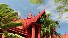 Pan across reddish Asian Cambodian traditional building Stock Footage