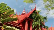 Stock Video Footage of Pan across reddish Asian Cambodian traditional building