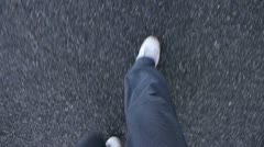 Walking on rough asphalt Stock Footage