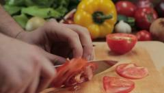 Chef cutting up a tomato with a knife, tracking shot HD Stock Footage