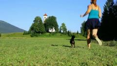 Girl and a dog running away Stock Footage