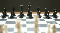 Dolly shot of chess board moving towards opponent Stock Footage