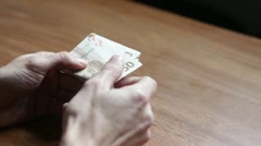Man counting stack of money euros professionally - stock footage