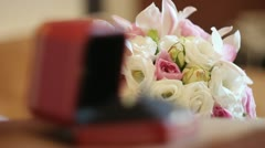 a wedding bouquet and rings - stock footage