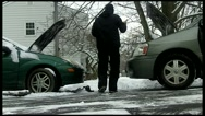 Jump Start Car Battery in Winter with Snow Stock Footage