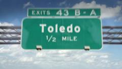 A Highway/Interstate sign going into the city of Toledo, Ohio - stock footage