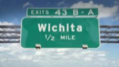 A Highway/Interstate sign going into the city of Wichita, Kansas - stock footage