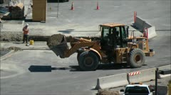 Front Loader hauls dirt at constuction site Stock Footage