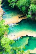 Stock Photo of beautiful arial view of turquoise waterfalls semuc champey in guatemala