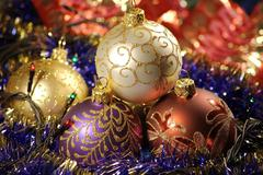 Christmas baubles & gold ribbons Stock Photos