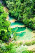beautiful arial view of turquoise waterfalls semuc champey in guatemala - stock photo
