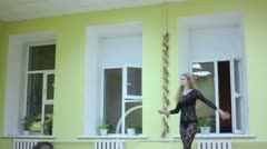 Young girl makes gymnastic performance with hoop in room Stock Footage