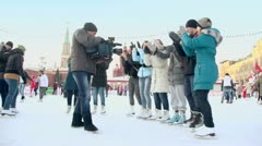 TV operator records group of students which dance at GUM rink Stock Footage