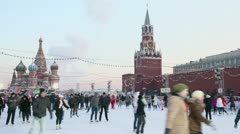 Many people ride on skates at GUM rink on Red square Stock Footage