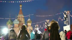 Many people ride on skates at GUM skating-rink on Red square Stock Footage