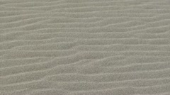 Wind rippled sands and seacoast Stock Footage
