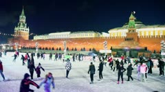 People ride on skates at GUM rink on Red square Stock Footage