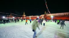 People ride on skates at GUM rink on Red square with mausoleum Stock Footage