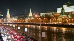 Many cars in traffic at kremlin quay on winter night in Moscow Stock Footage