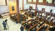Journalists and churchgoers in moscow synagogue Beis Menachem Stock Footage