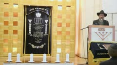 Chief Rabbi of Russia Berel Lazar reads prayer in synagogue Stock Footage