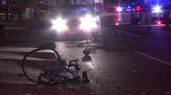 Bicyclist hit by car bike mangled Stock Footage