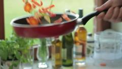 Vegetables being flipped from a frying pan, slow motion HD Stock Footage