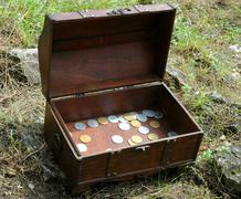 Trunk with coins - stock photo