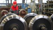 Worker controls wheels of rail vehicles Stock Footage