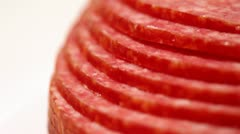 Sliced ??and laid out terraces circles revolve salami sausage Stock Footage