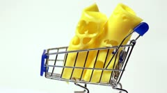 Two rolls of cheese to rotate on a small trolley isolated Stock Footage
