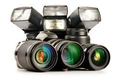 composition with photo equipment including zoom lenses, camera and flash lights  - stock photo