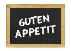 guten appetit  on a blackboard - stock illustration