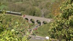 Vintage Diesel Commuter Train Passing Over Bridge Stock Footage