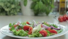 Preparation of vegetable salad, tracking shot HD - stock footage