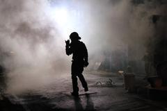 Riot policeman in smoke Stock Photos