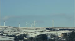Wind farm in winter partially becalmed Stock Footage