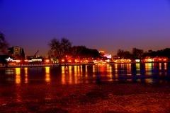 Stock Photo of Frozen lake in front a Beijing bar district