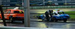Stock Photo of Banger racer removing tire