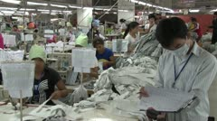 Stock Video Footage of Textile Clothing Factory: Factory supervisor with clipboard and workers
