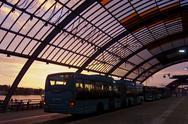 Stock Photo of sunrise Amsterdam bus terminal